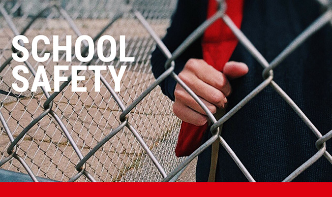 image of school safety text, child behind school fence